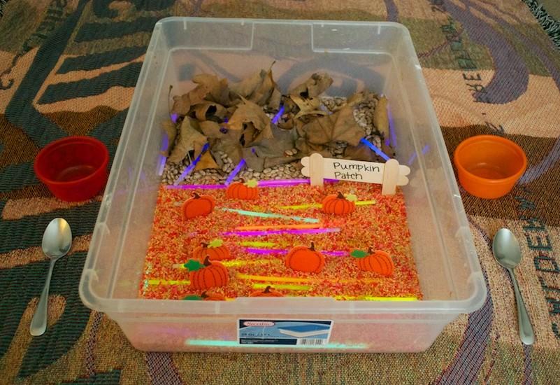 halloween activities for kids - glowing pumpkin patch sensory bin