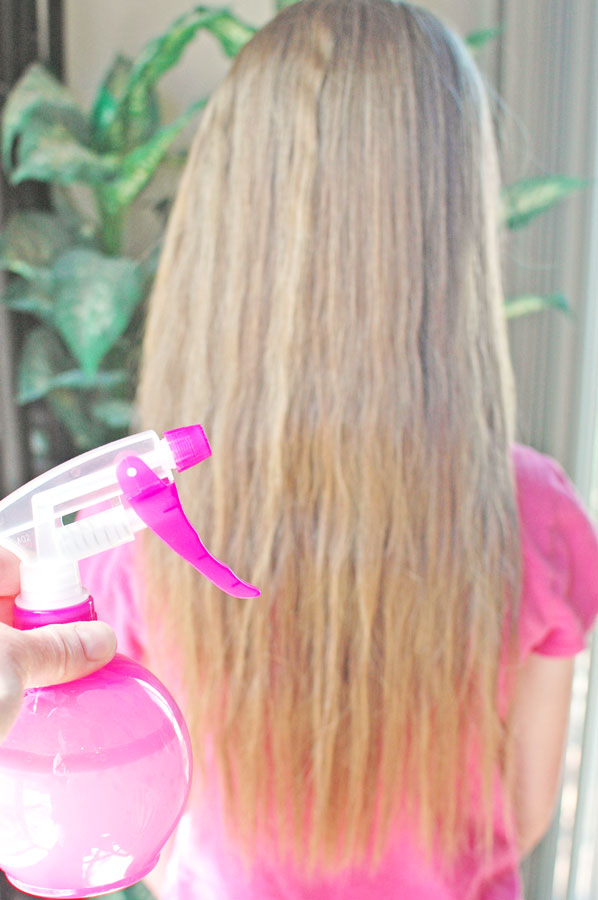 homemade hair conditioner spray on girl's hair