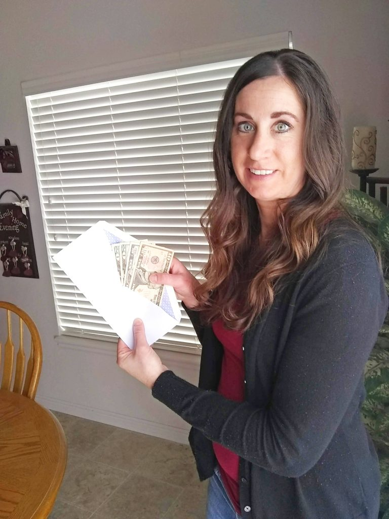 Holding cash in an envelope